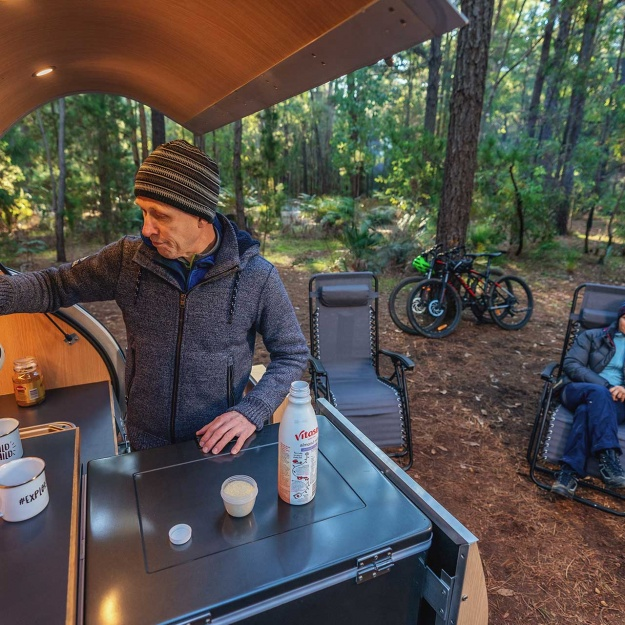 Lane_Poole_Reserve_Camping_Couple_Camper_Trailer_Man_Making_Coffee_Woman_Sittting-credit-Josh-Cowling